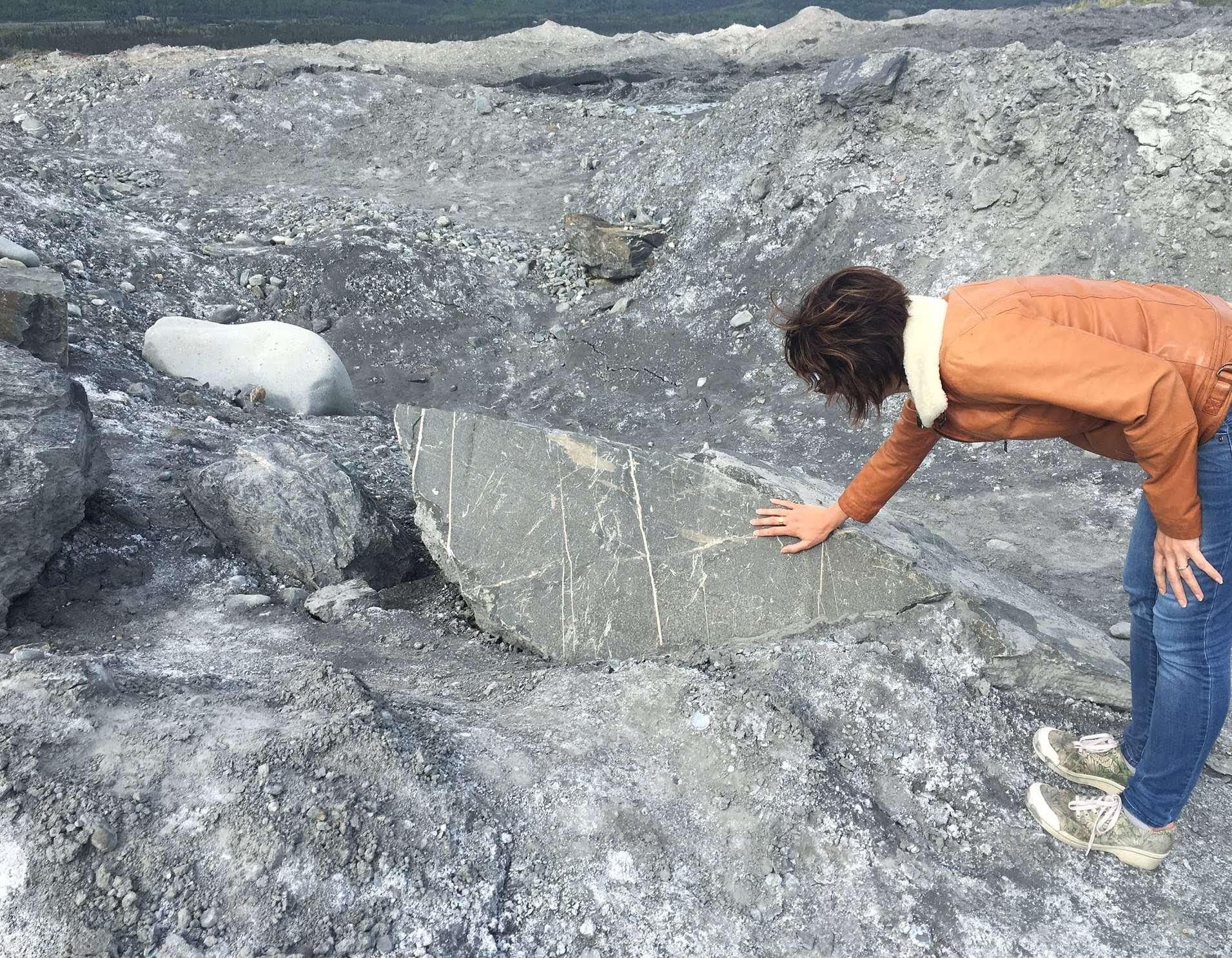 MT in Alaska, examining some rocks